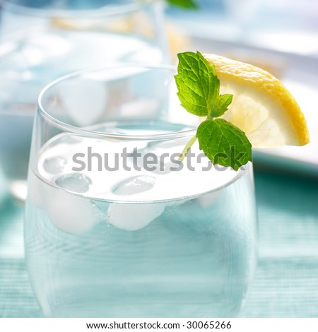 glass of water with lemon and mint. shallow dof - stock photo