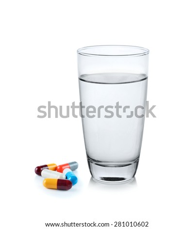 glass of water with pill capsule - stock photo