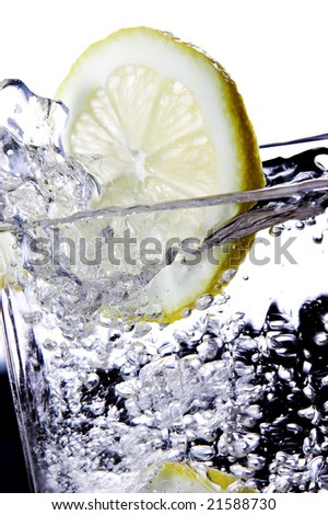 Glass of water with slice of lemon - stock photo