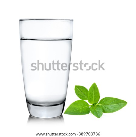 Glass of water with sweet basil  isolated on white background - stock photo