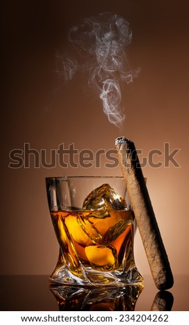 Glass of whiskey and cigar on brown background - stock photo
