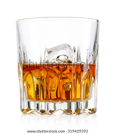 Glass of whiskey and ice isolated on white background - stock photo