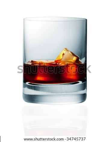 glass of whiskey and ice isolated over black background - stock photo