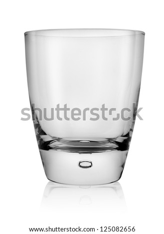 Glass of whiskey isolated on a white background