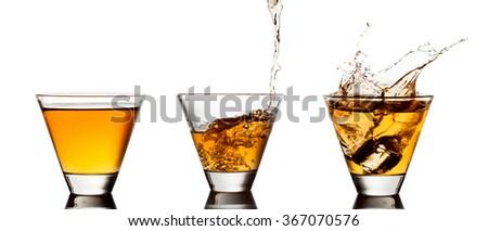 Glass of whiskey isolated on white background. - stock photo