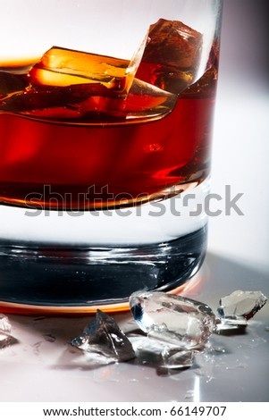glass of whiskey on a gray background - stock photo