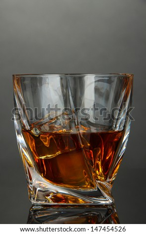 Glass of whiskey, on dark background - stock photo