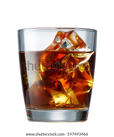 glass of whiskey with ice cubes isolated on white