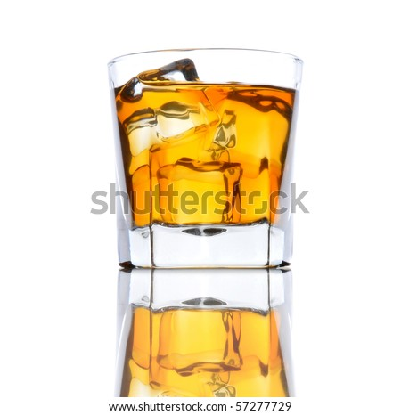 Glass of Whiskey with ice from a low angle on black bar counter white background - stock photo