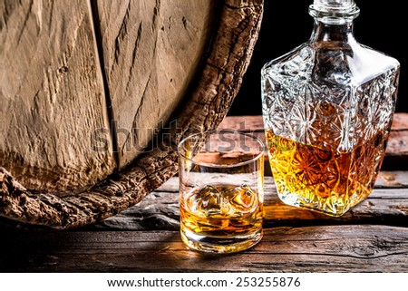 Glass of whisky in the old cellar - stock photo