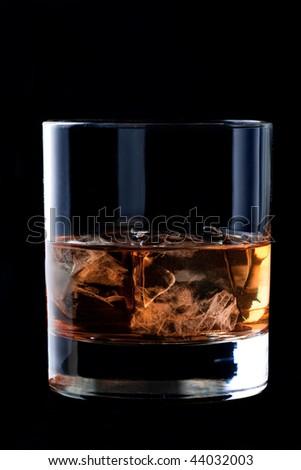 glass of whisky on black background. - stock photo