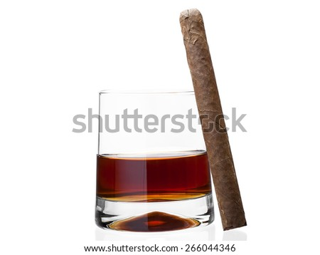 Glass of whisky with a cigar on a white background of nobody, alcoholic drink of yellow color with a tobacco product a cigar - stock photo