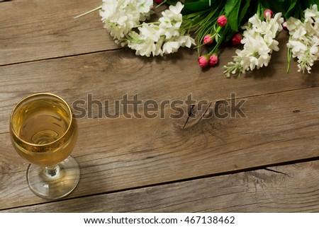 Glass white wine flowers flat lay stock photo royalty free glass of white wine and flowers flat lay mightylinksfo