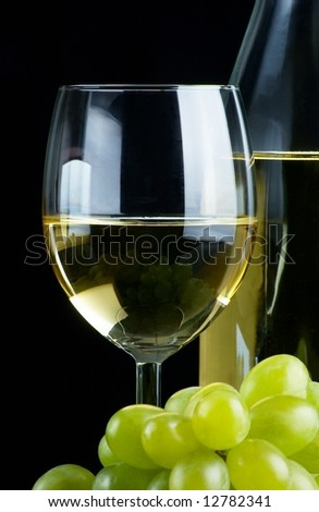 Glass of white wine on black background