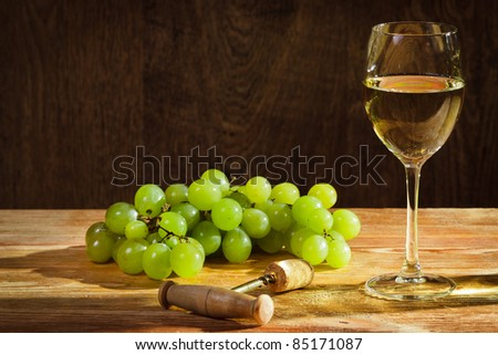 Glass of white wine with grapes