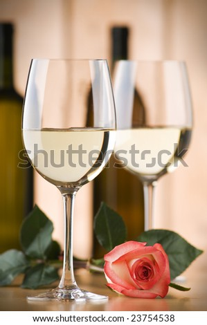 glass of white wine with rose close up shoot - stock photo