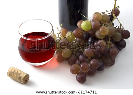 glass of wine, grapes, and cork