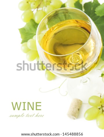 Glass of wine, grapes, leaves and cork isolated on white with sample text - stock photo