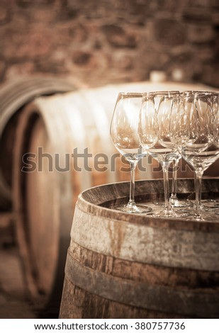 Glass of wine in the wine cellar - stock photo