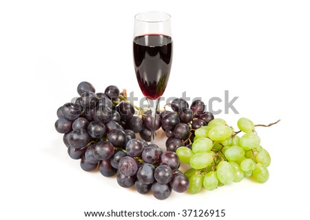 Glass of wine on a background the vine of red and green color.   Isolated on a white background.