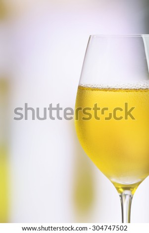 Glass of wine on light blurred background - stock photo