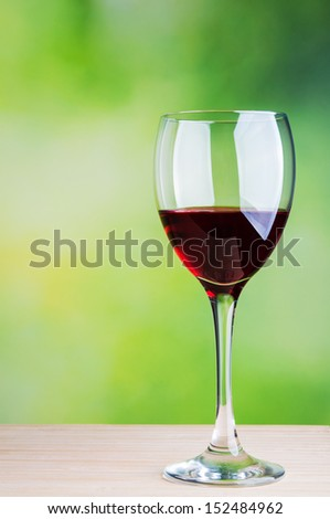 Glass of wine on natural background - stock photo