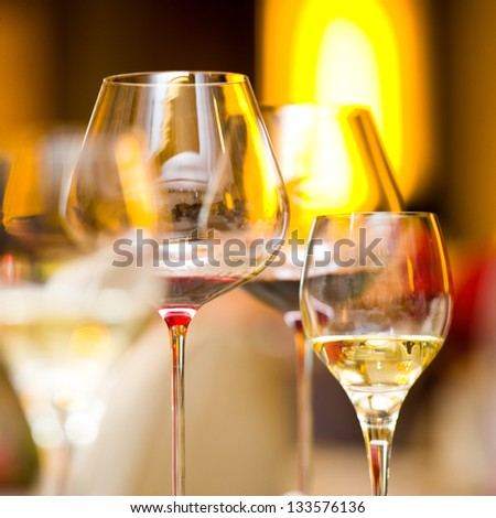 Glass of wine on table.