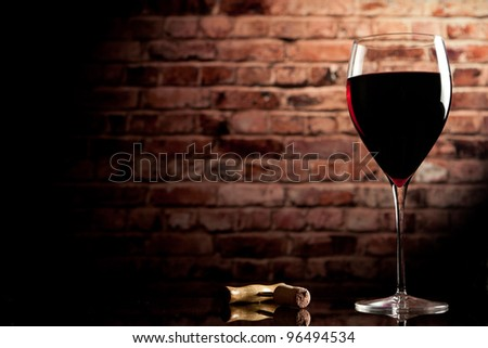 glass of wine on the background of a brick wall - stock photo