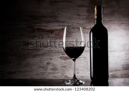 glass of wine over grunge background - stock photo