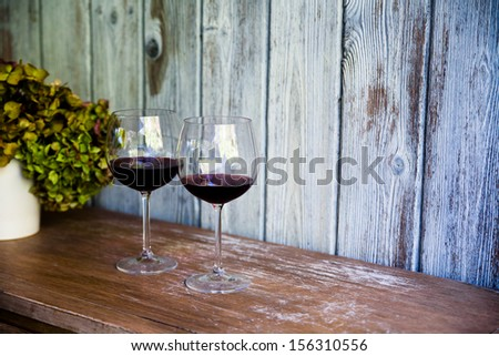 Glass of wine. Rustic vintage setup. Food and beverage concept - stock photo