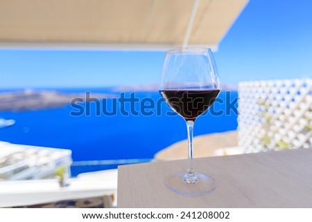 glass of wine Santorini greece in summer - stock photo