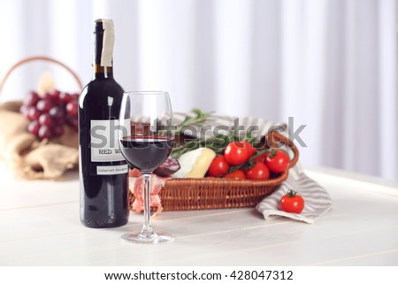 Glass of wine with food on blurred background - stock photo