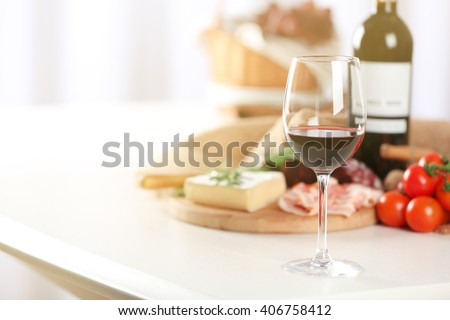 Glass of wine with food on table closeup