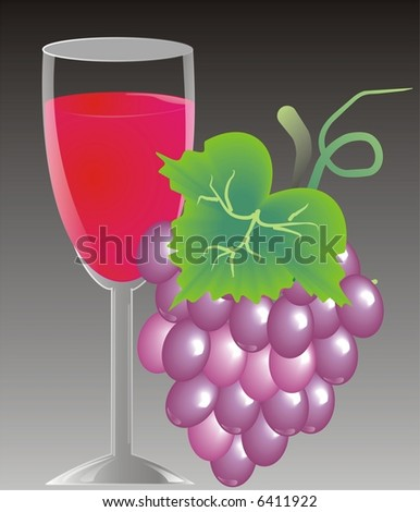 Glass of wine with grapes - stock photo