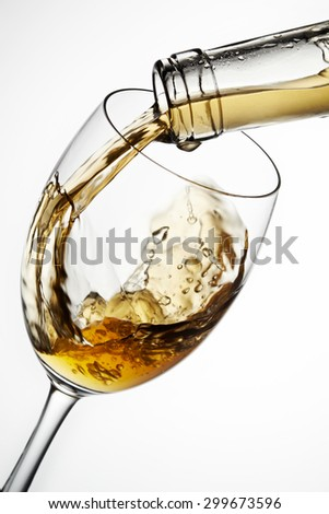 Glass of wine with splash, isolated on white background