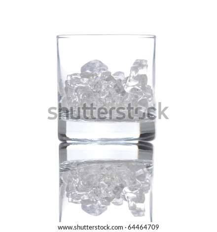 Glass partially filled with ice cubes, isolated over white with reflection. - stock photo