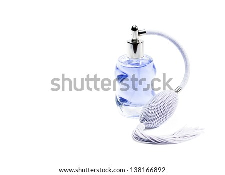 Glass perfume bottle with pump. - stock photo