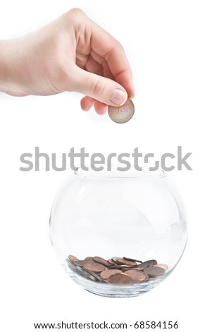 glass piggy bank with coins on white background