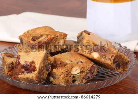 Glass plate of nutty peanut butter squares
