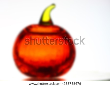 Glass pumpkin blur - stock photo