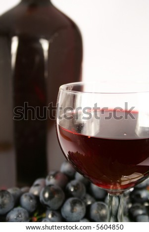 Glass red wine and grape