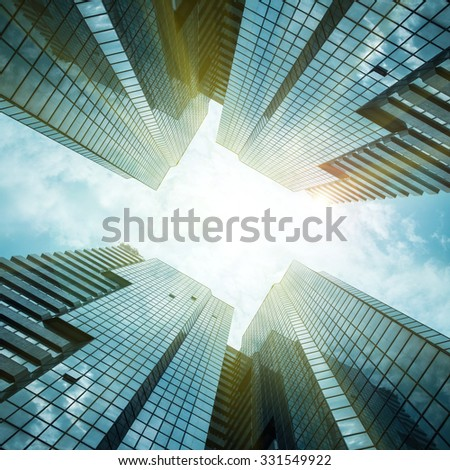 glass reflective office buildings against blue sky with clouds  - stock photo