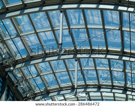 Glass roof of modern building with background of clear blue sky       - stock photo