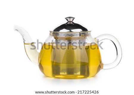 Glass tea pot with tea. Isolated on a white background. - stock photo