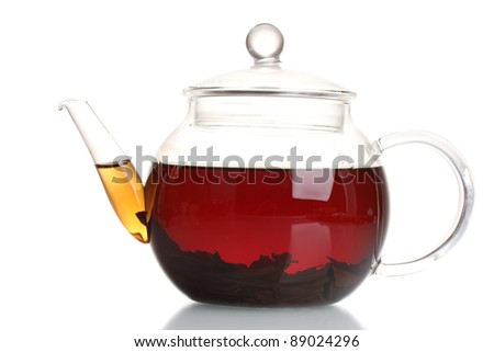 Glass teapot with black tea isolated on white - stock photo
