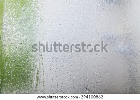 Glass texture background on shower room in bathroom with water drops - stock photo