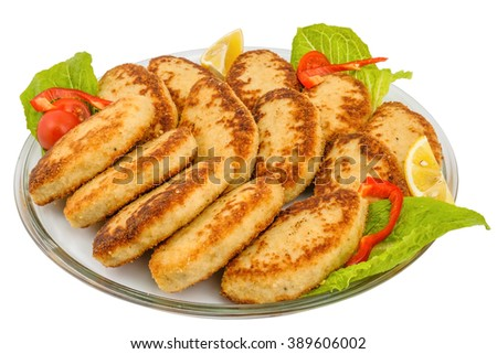 Glass tray with fish cakes decorated with salad leaves, slices of lemon, tomato and pepper, on white background - stock photo