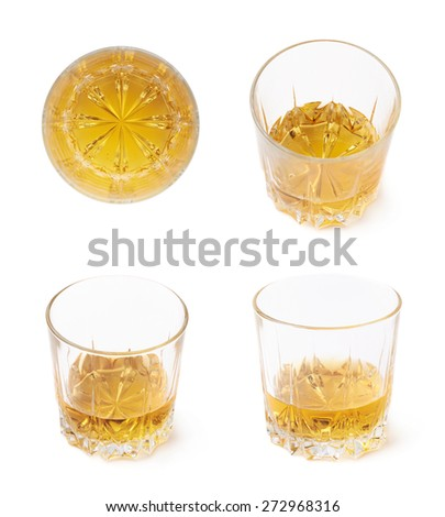 Glass tumbler filled with whiskey bourbon isolated over the white background, set of four different foreshortenings - stock photo