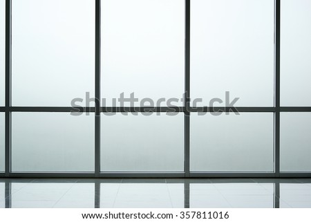 Glass wall background interior of modern office building - stock photo