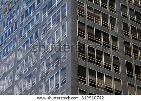 Glass wall of a building and sky reflection, abstract view - stock photo